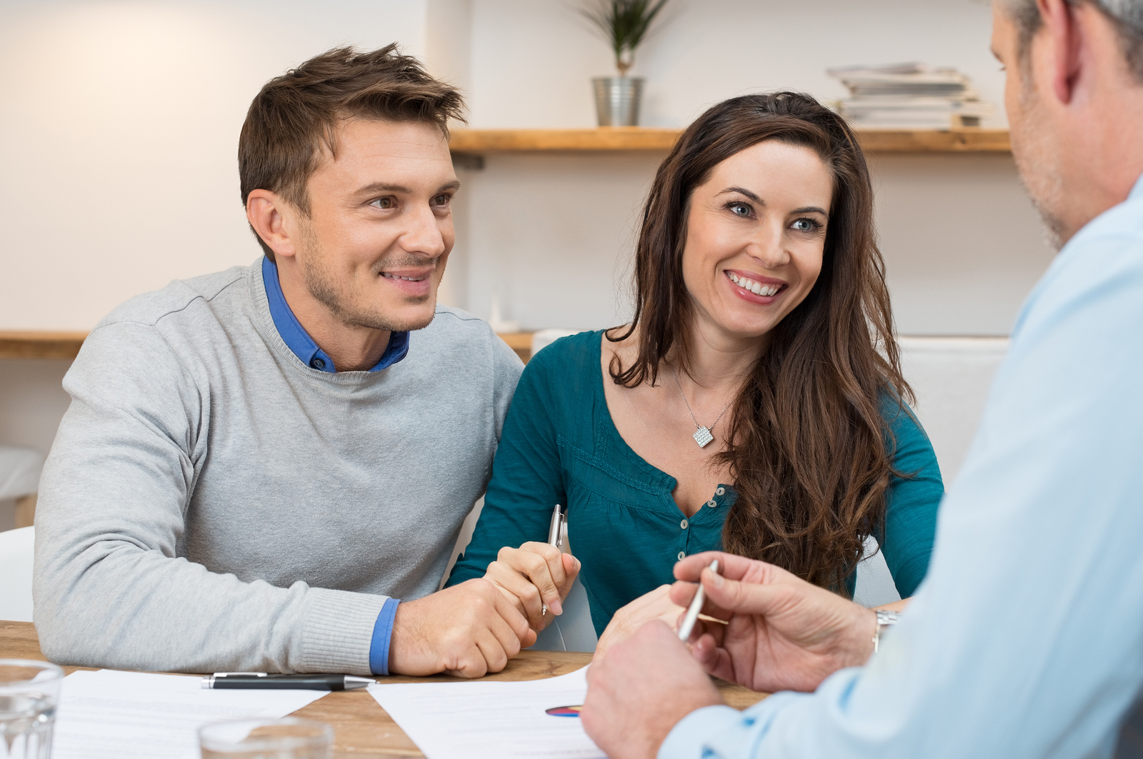 Young couple working with a mortgage loan officer florida